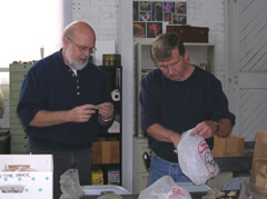 Dr. Hank Koerper and Scott Findlay examining unprovenienced material at Curation Facility